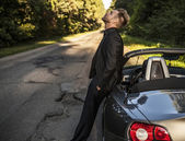 Elegant young handsome man and convertible car. Outdoor photo. — Stock Photo