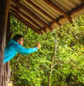 Tourist making picture in Rainforest — Stock Photo
