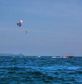 Parasailing and boat — Stock Photo