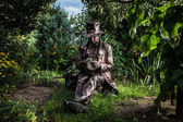 Image of watchmaker in bright fantasy stylization. Outdoor fairy tale art photo. — Stock Photo