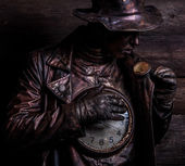 Image of watchmaker in bright fantasy stylization. Fairy tale art photo on grunge wooden background. — Stock Photo