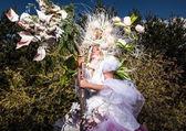 Fashion image of sensual girl in bright fantasy stylization. Outdoor fairy tale art photo. — Stock Photo