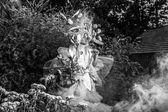 Fashion image of sensual girl in bright fantasy stylization. Black-white outdoor fairy tale art photo. — Stock Photo