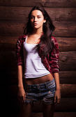 Young sensual & beauty woman in casual clothes pose on grunge wooden background. — Stock Photo