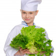 Smiling cook with fresh herbs — Stock Photo