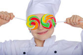 Young chef closed his eyes colored candies — Stock Photo