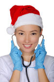Christmas doctor with stethoscope in gloves — Stock Photo