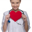 Doctor with stethoscope holding a heart — Stock Photo #39274835