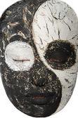Portrait of an oriental woman in mask — Stock Photo