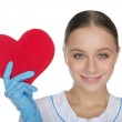 Female doctor in gloves shows a heart symbol — Stock Photo #41522031