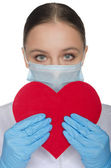 Portrait of a doctor with red heart symbol — Stock Photo