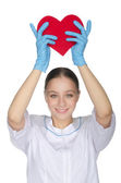 Female doctor held up a heart symbol — Stock Photo