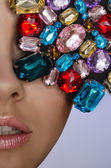 Woman with multicolored stones — Stock Photo