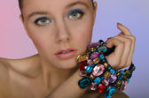 Woman with a bracelet of colored stones — Stock Photo