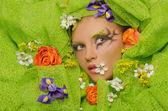Beautiful woman in flowers — Stock Photo