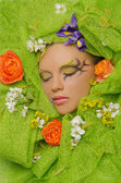 Vertical portrait of beautiful woman in flowers — Stock Photo