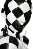 Portrait with chess makeup and pieces — Stock Photo