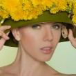 Young woman in helmet with a wreath of dandelions — Stock Photo #47975183