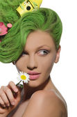 Woman with watering can and starling house in hair — Stock Photo