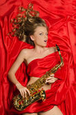 Woman with golden saxophone — Stock Photo
