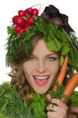 Woman with carrot, radish and greens — Stock Photo