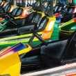 Electric cars in amusement park — Stok fotoğraf