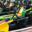 Electric cars in amusement park — Stock fotografie