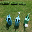 Stock Photo: Three plastic watering cans