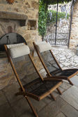 Comfortable wooden chairs in the backyard — Stock Photo