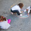 Υoung children painting on the road — Stock Photo