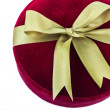 Dark red gift box with a green bow on white background — Stock Photo #29358181
