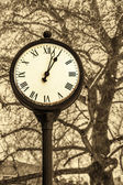 Old style clock — Stock Photo