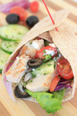 Greek salad chicken wrap — Stock Photo