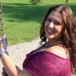 Stock Photo: Beautiful 40 year old woman on swing