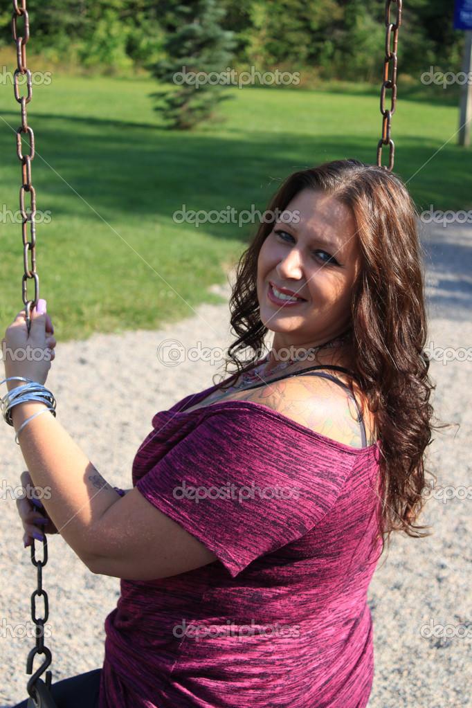 Beautiful 40 Year Old Woman On Swing Stock Photo