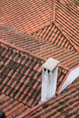Red clay tubular tiled rooftops — Stock Photo