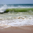 Crashing waves on beach shore — Stock Photo #25329987