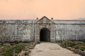 Sagres fortress entrance in rugged terrain — Stock Photo