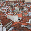 Stock Photo: Red rooftops of Lisbon, Portugal buildings