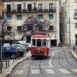 Historic streetcar in Alfama Lisbon — Stock Photo #26342047