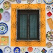 Artisan's wall of handpainted plates — Stock Photo