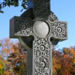 Stock Photo: Decorated cross in cemetery during autumn