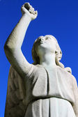 Angel statue looking up towards sky — Stock Photo