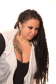 Tattooed woman with piercings and dreadlocks — Stock Photo