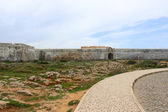 Sagres fortress in rugged terrain — Stock Photo