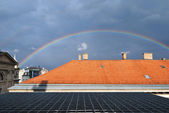 Rainbow over the roofs — Stock Photo