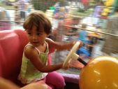 Blurred movements of a Baby enjoying the merry go round — Stock Photo