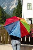 Multicolor Umbrella with Dolomites Mountains Background — Stock Photo