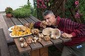 Man sniffing Boletus Mushrooms — Stock Photo