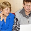 Senior Couple using Notebook for a Video Call — Stock Photo